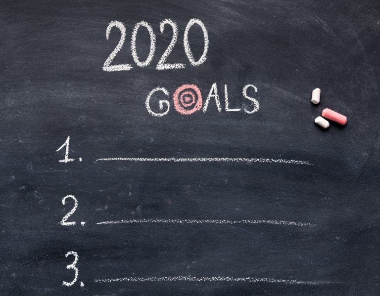 New year goals with items hanwriting on chalk board